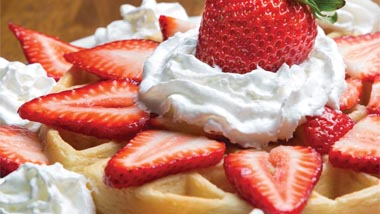 Waffle with Whipped Cream and Strawberries
